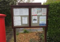 Peakirk parish council notice board with post box on left